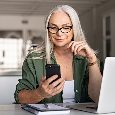 Woman with ICAN Neuro System on Phone